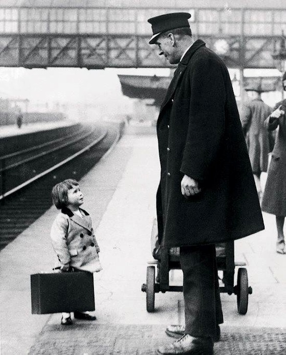 A-young-passenger-asks-a-station-attendant-for-directions.-Bristol-Railway-Station-England-1936-Photo-George-W.-Hales-